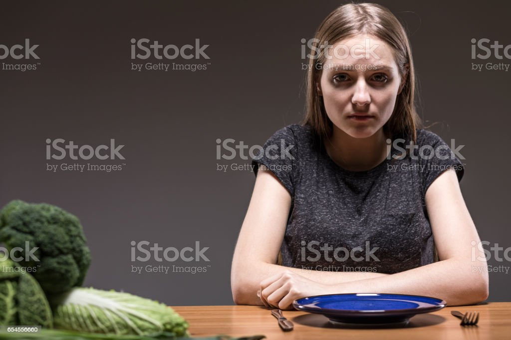 Not willing to concentrate on healthy nutrition stock photo