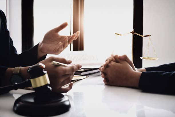 notary consultant concept , Judge gavel with client consult lawyer lawsuit bankruptcy of her. Concepts of law. notary consultant concept , Judge gavel with client consult lawyer lawsuit bankruptcy of her. Concepts of law. lawsuit stock pictures, royalty-free photos & images