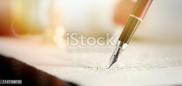 istock Notary or attorney signs legal contract 1147159720