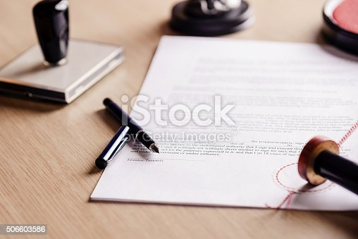 Notary pen lying on testament. Notary public working accesories