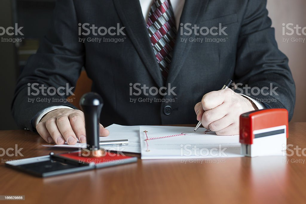 Notary Public in his office signed a contract stock photo