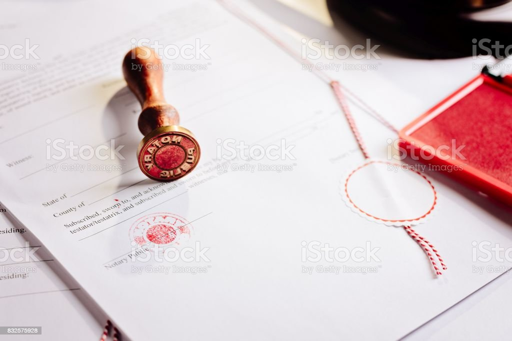 Notary Public Metal Stamper On Testament Stock Photo