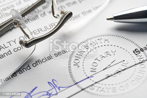 Notary Public: Seal embossed on document with pen and glasses