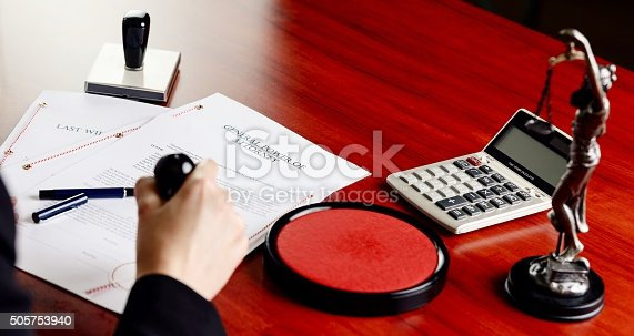 854317150istockphoto Notary public stamping power of attorney. 505753940