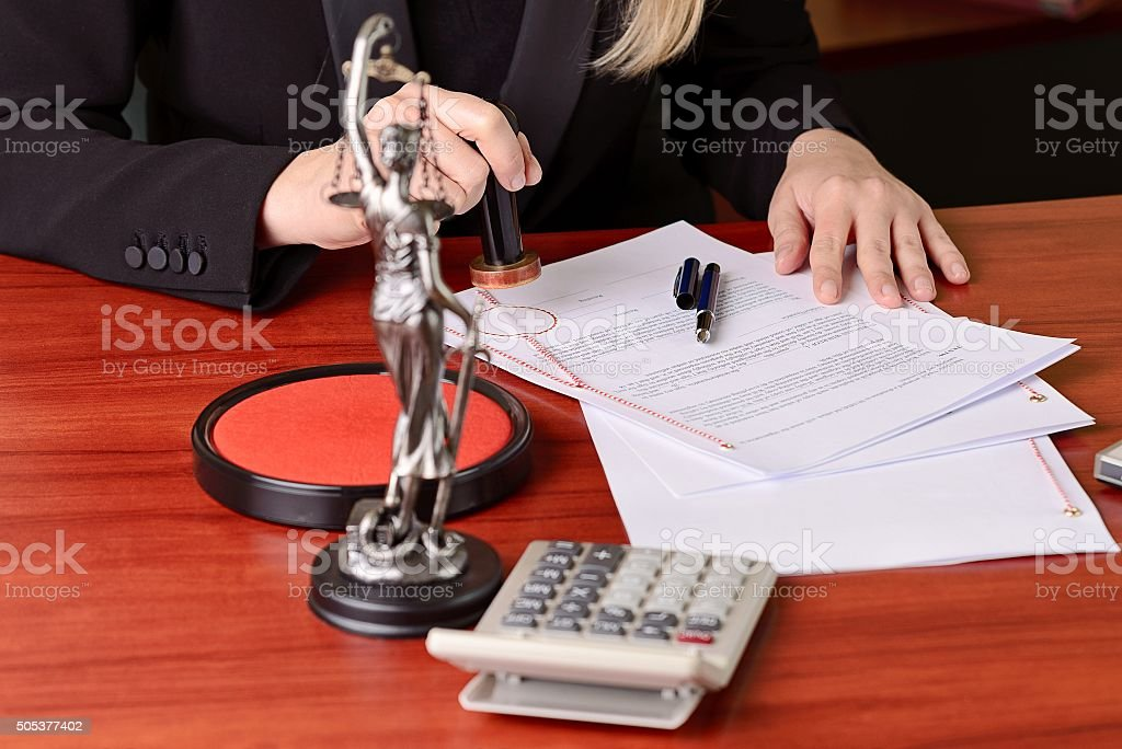 Notary public stamping the agreement on rosette stock photo
