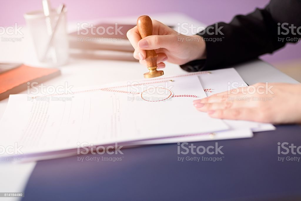 Notary Public stamping the document stock photo