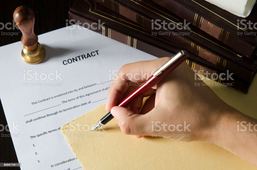 Notary signing a contract with fountain pen. stock photo