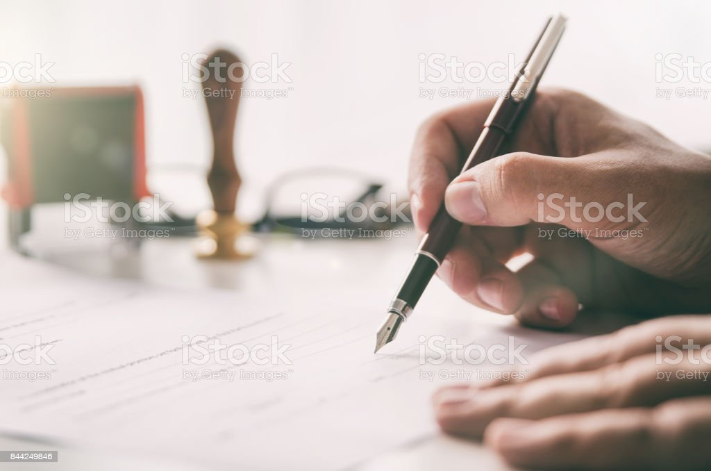 Notary signs legal contract. Businessman working in office royalty-free stock photo