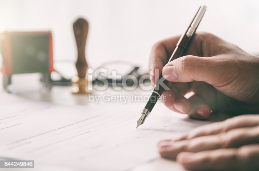 istock Notary signs legal contract. Businessman working in office 844249846