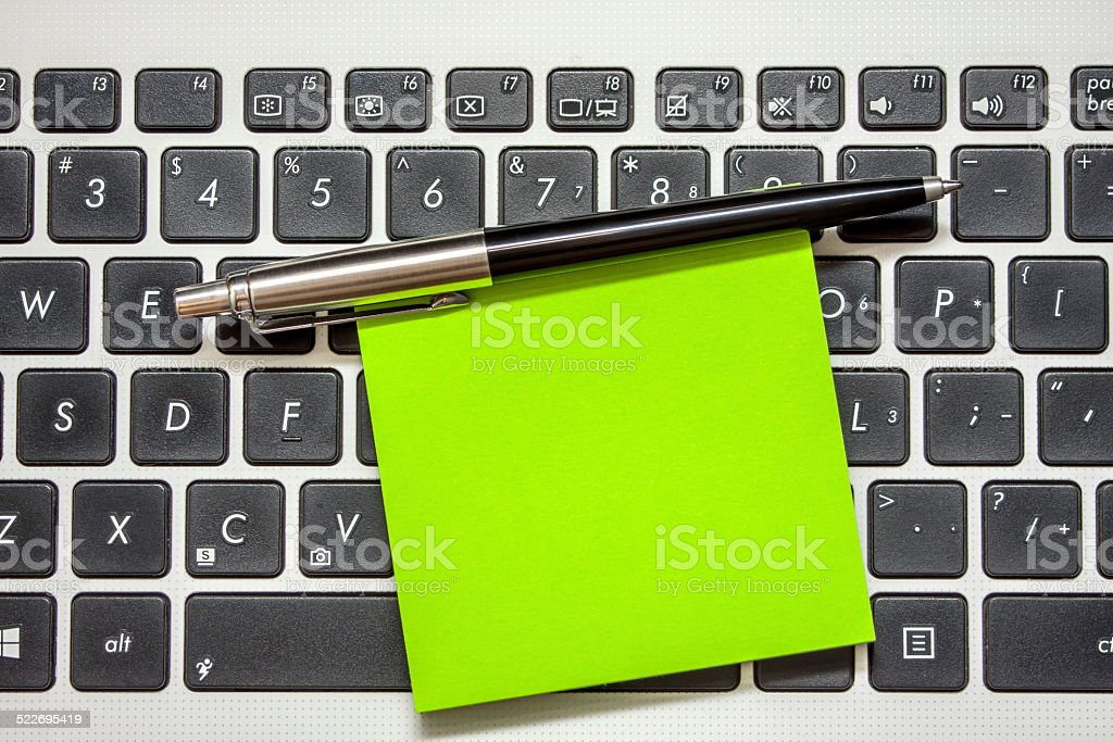 Note and pen stock photo