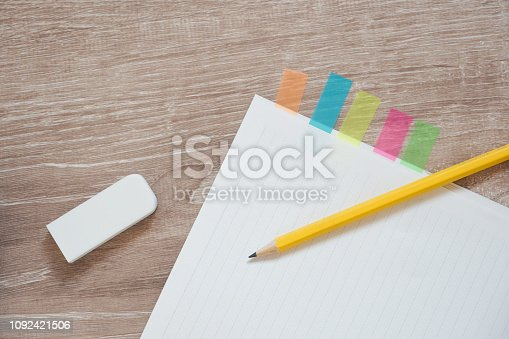 Note and pencil on the desk.