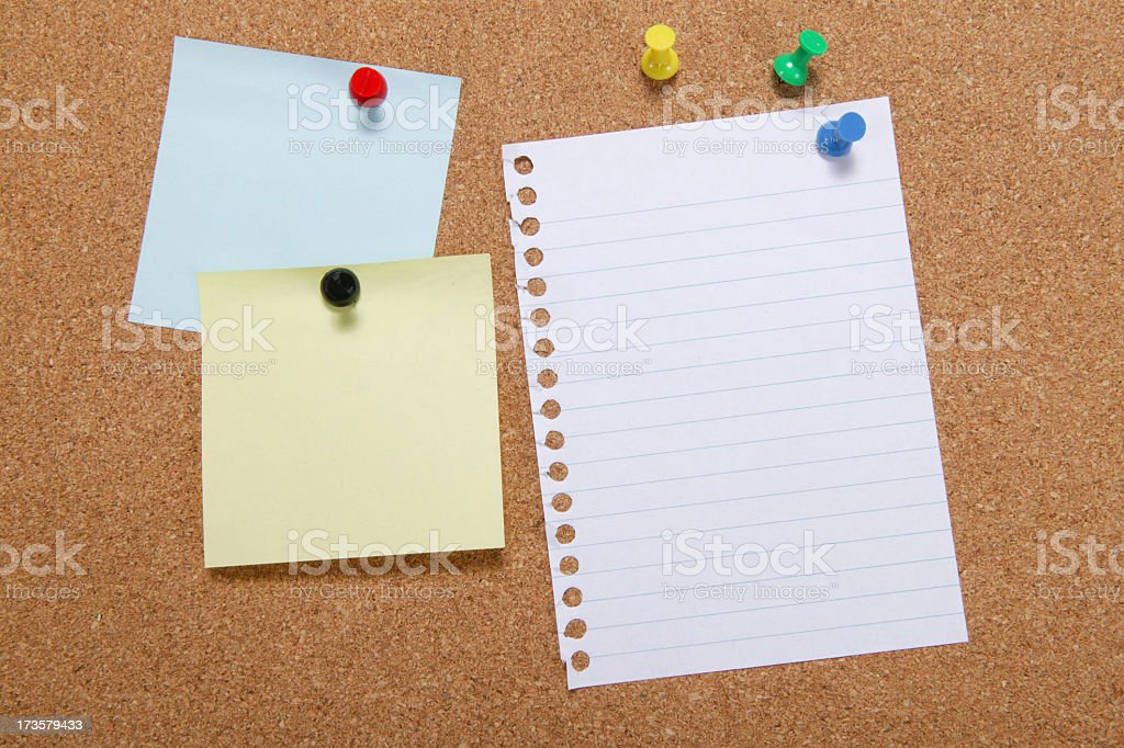 A note board with paper and notes pinned on to it royalty-free stock photo