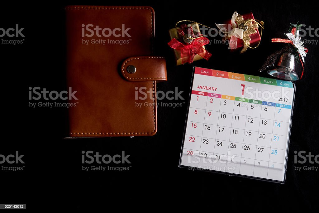 note book and calendar on black background stock photo