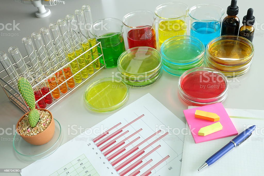 note book and chart with colorful fluid in glassware stock photo