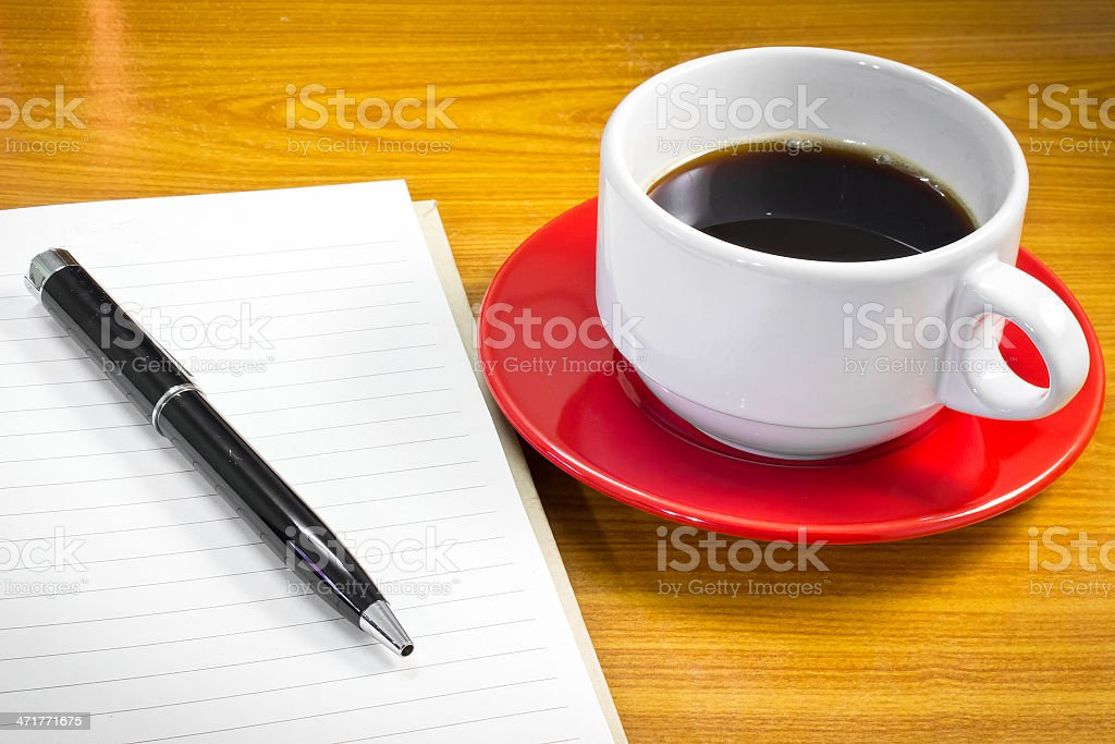 Note book and pen with a cup of coffee royalty-free stock photo