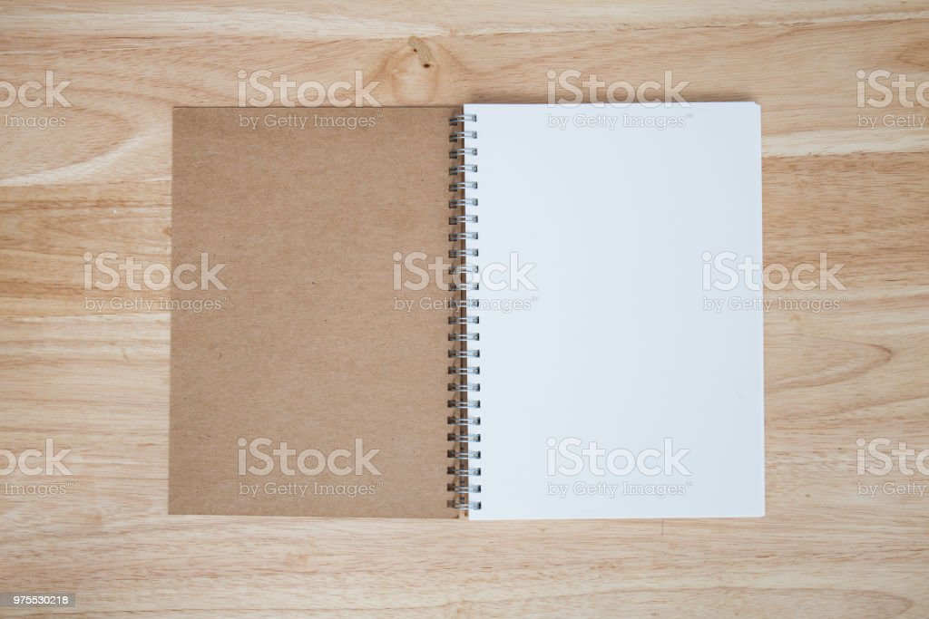 note book on wood table stock photo