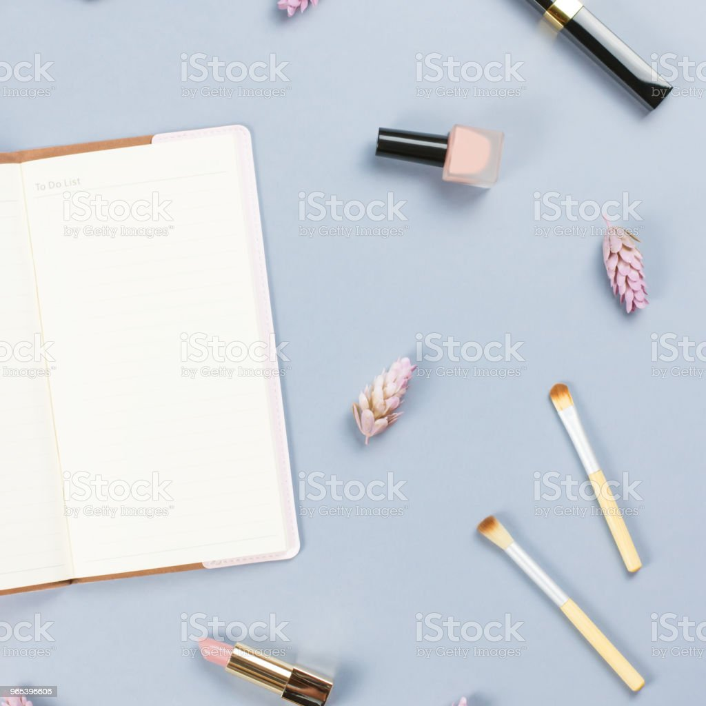 Note book, woman beauty accessories flat lay on pastel background. Fashion or beauty blogger concept. zbiór zdjęć royalty-free