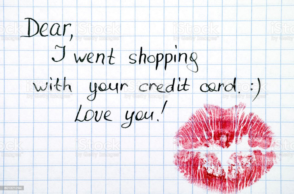 Note - Dear, I went shopping with  your credit card. Love you! with kiss. stock photo