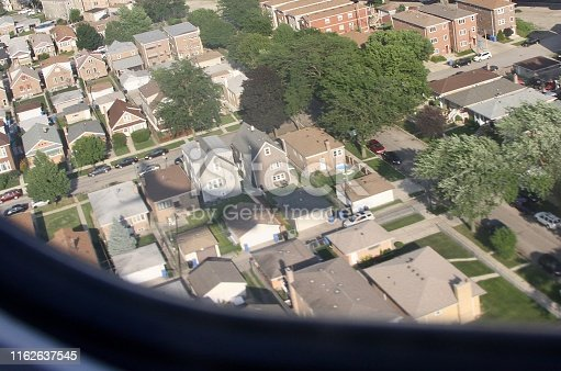 Note the shadow of the jet as it comes in for a landing in Chicago