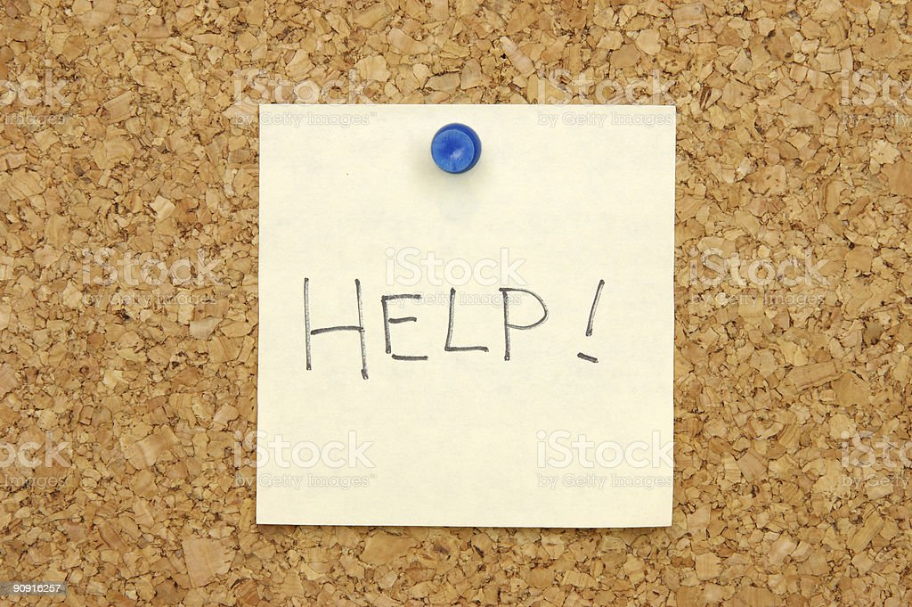 Note on corkboard asking for help stock photo
