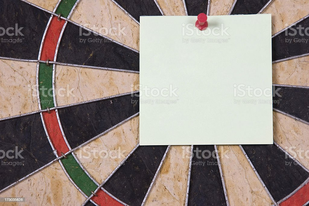 Note on Dartboard. royalty-free stock photo