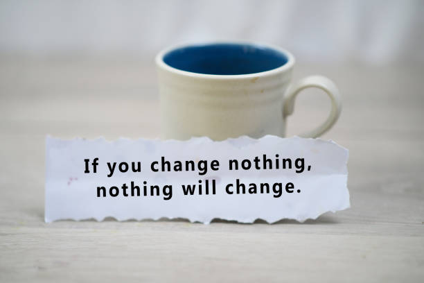 Note on paper - If you change nothing, nothing will change. Inspirational quote - Be kind to yourself today. Happy Tuesday. With a cup of morning coffee and a white paper note concept on white wooden table background. Tuesday coffee and motivational words concept. fresh start morning stock pictures, royalty-free photos & images