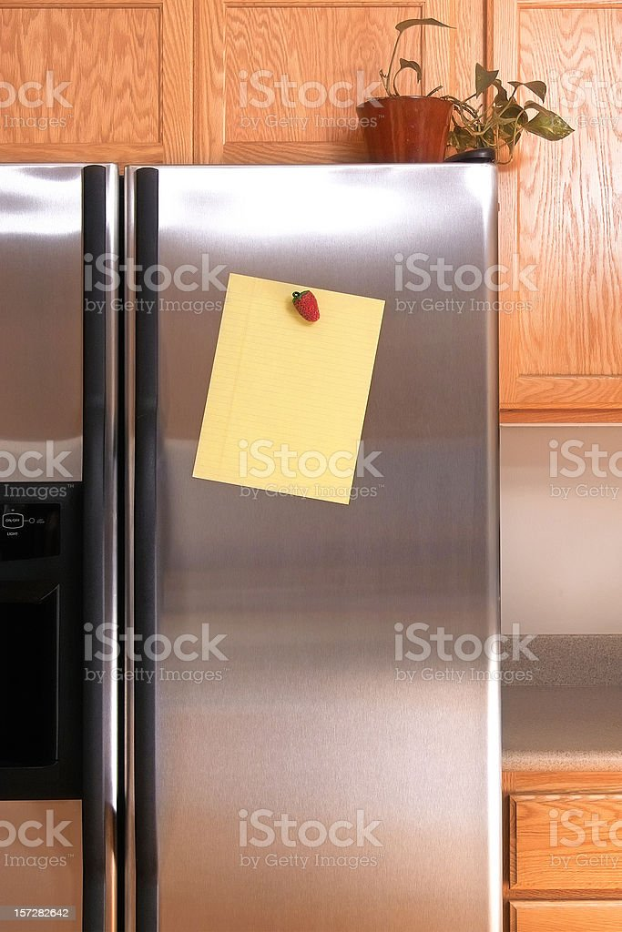 Note on Refrigerator Door stock photo