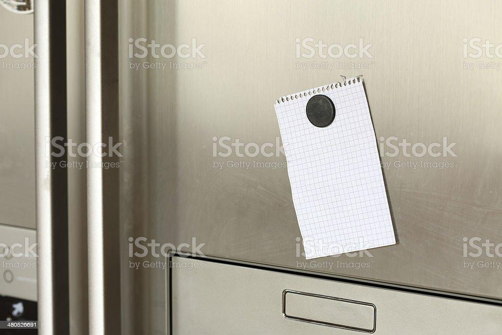 Note on refrigerator stock photo
