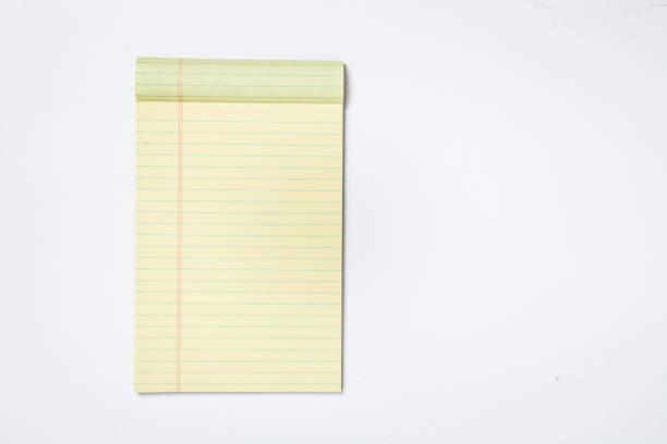 note pad on a white background - folha de caderno imagens e fotografias de stock