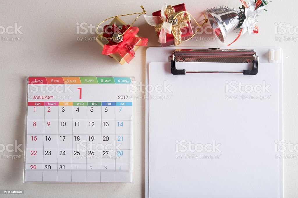 note pad with blank page and calendar stock photo
