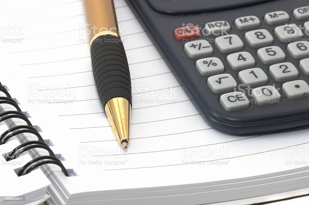 Note pad with pen and calculator royalty-free stock photo
