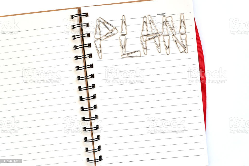 Note paper, new open notepad for writing on a white background, pen,...