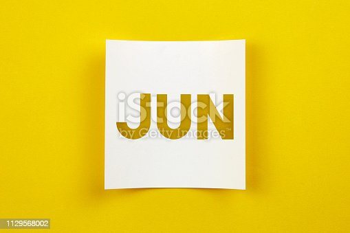 istock Note paper with June word on it 1129568002