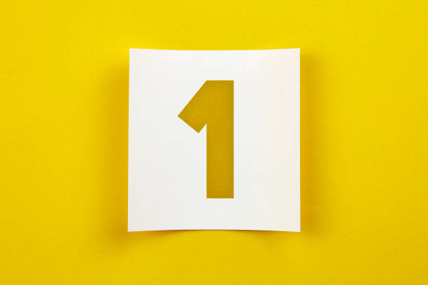 Note paper with number one on it White note paper on yellow background number 1 stock pictures, royalty-free photos & images