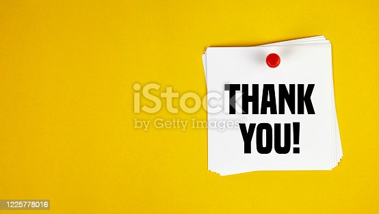 Note paper with thank you message on yellow background. Horizontal composition with copy space. Thanks Concept.
