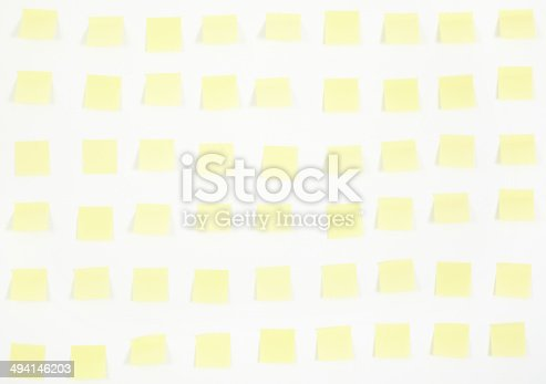 istock note papers and clock on office wall business 494146203