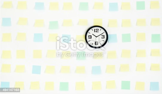 istock note papers and clock on office wall business 494147163
