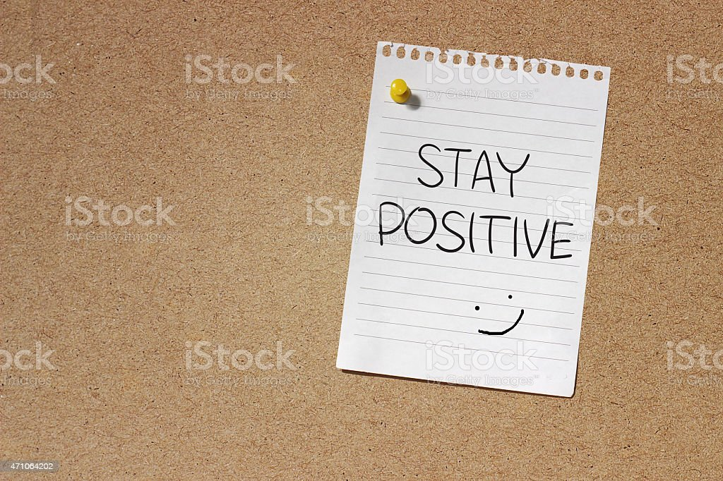 A note pinned up to remind you to stay positive stock photo