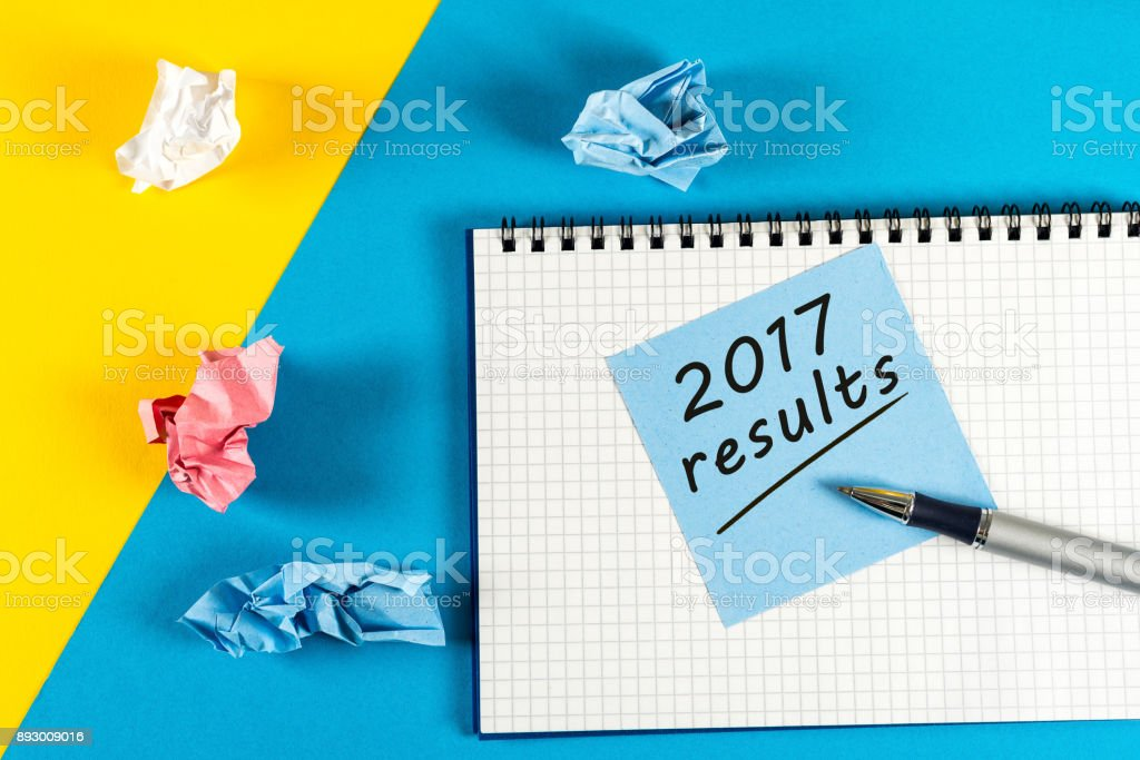 Note reminder to prepare an annual report - 2017 results. New year 2018 - Time to summarize and plan goals for the next year. Business background stock photo