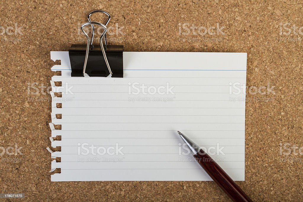 Note with clip and pen royalty-free stock photo
