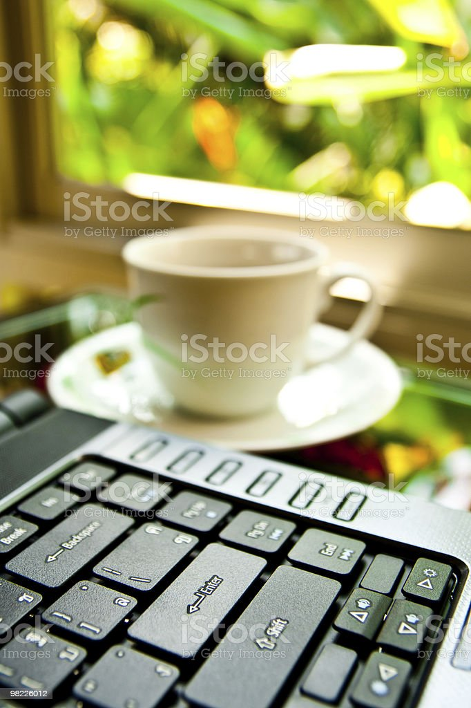 Notebook and coffee cup royalty-free stock photo