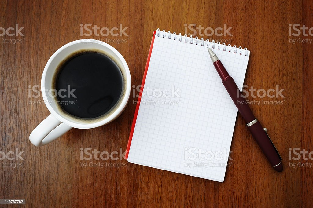 Notebook and coffee royalty-free stock photo