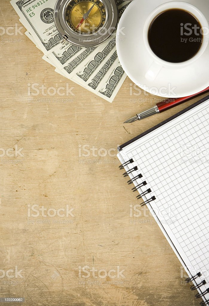 notebook and coffee with dollar royalty-free stock photo