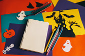 istock notebook and handmade paper decorations for Halloween 612849390