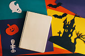 istock notebook and handmade paper decorations for Halloween 612851086