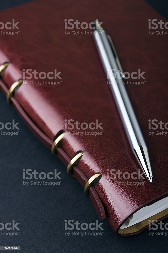 Notebook and pen in composition in black stock photo