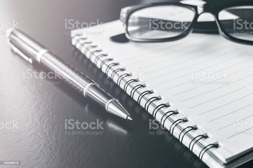 notebook and pen on desk office, workplac stock photo