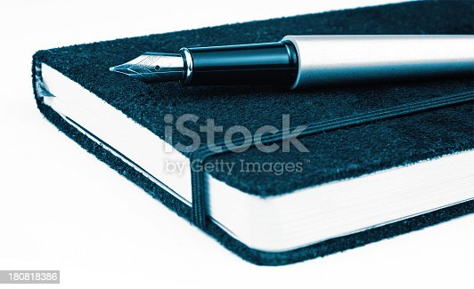 istock Notebook and pen 180818386