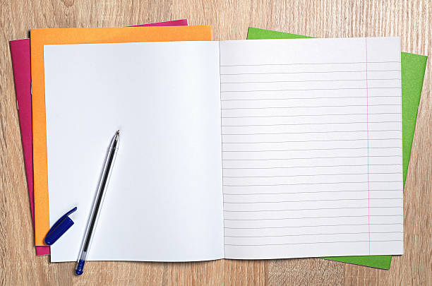 Notebook and pen Opened notebook and pen on table, top view workbook stock pictures, royalty-free photos & images
