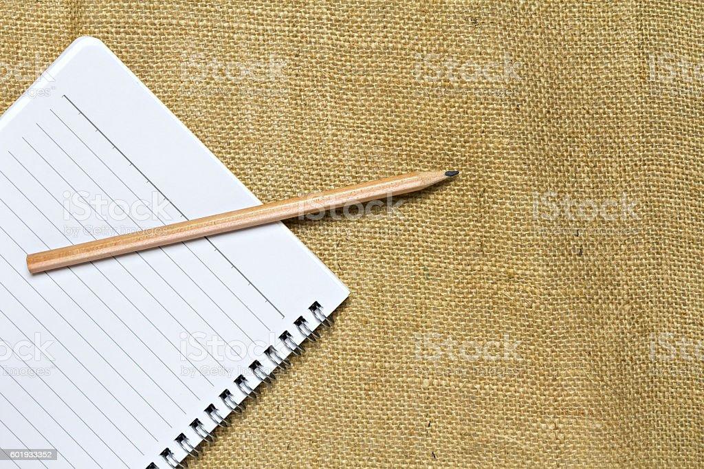 Foto De Notebook And Pencil On Burlap Linen Fabric E Mais Fotos De Stock De Acima Istock